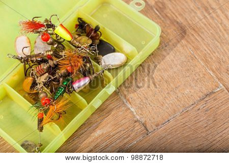 Closeup Heaps Of Fishing Bait Lures In Box