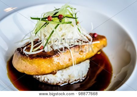 Foie Gras and Yaki Onigiri Steak Grilled onigiri topped with sautéed foie gras, served with teriyaki