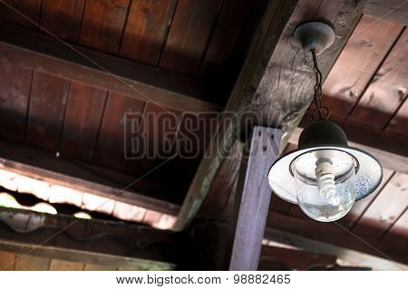 Vintage Country Lamp On Wooden Ceiling
