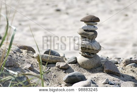 Stone Tower And Plants On A Natural Sandy Beach
