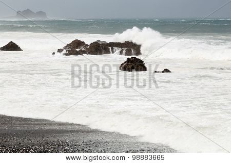 Stormy Sea During Typhoon, Waves Breaking Over Rocks