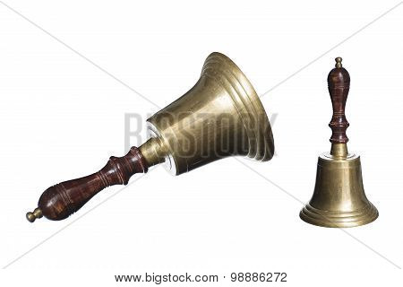 Old School Bell Or Hand Bell Made Of Brass With Wooden Handle Isolated On A White Background