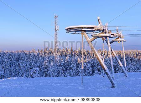 Downhill slope and ski-lift equipment.