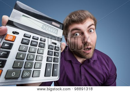 Surprised man with calculator