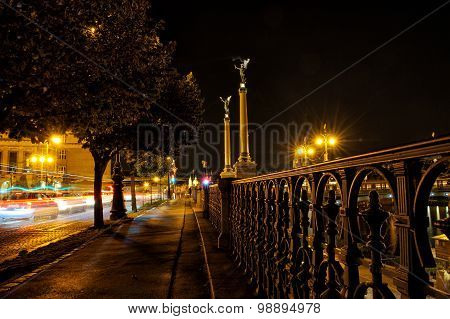 Night Street With Trees And Steel Banisters Close To Riverbank.