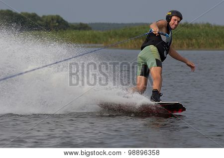 athlete doing tricks on a wakeboard