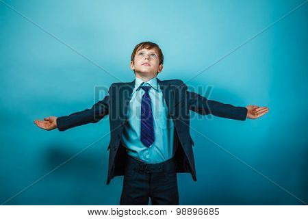 Teen boy businessman spread his arms look up dreams to fly like