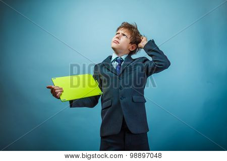 Teenage boy thinking businessman shaggy hair holding plate on a
