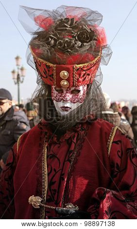 Masked Woman In Costume On San Marco Square, Carnival In Venice, Italy.
