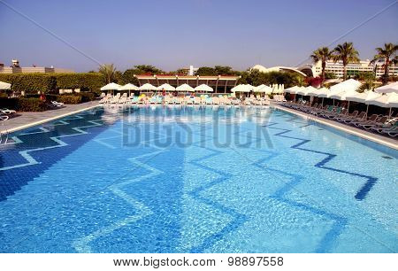 Hotel Swimming Pool With Sun Loungers