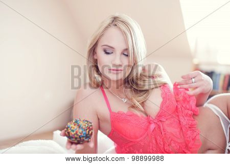 Sexy Blonde Woman In Bed Holding Doughnut