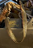 image of m60  - 62mm machine gun ammumition hanging out a military helicopter - JPG