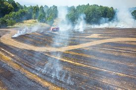 image of firemen  - Aerial view on the fireman truck working on the field on fire - JPG