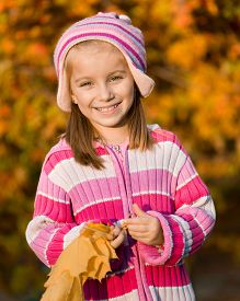 stock photo of mountain-ash  - smiling  girl  against the leaves of mountain ash - JPG