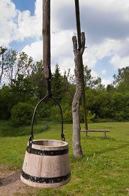 stock photo of shadoof  - Shadoof and wooden bucket hanging on it at the Witch - JPG
