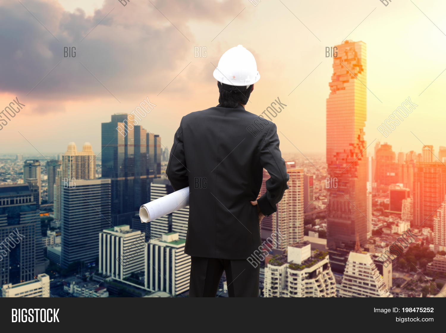 Management consulting engineers image photo bigstock management consulting with engineers working and holding blueprint engineer designer with helmet holding blueprint in his malvernweather Choice Image