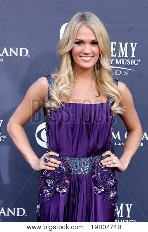 LAS VEGAS - APR 3:  Carrie Underwood arrives at the Academy of Country Music Awards 2011 at MGM Grand Garden Arena on April 3, 2010 in Las Vegas, NV.