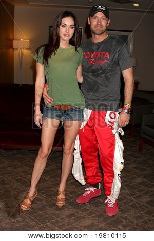 LOS ANGELES - APR 16:  Megan Fox, Brian Austin Green  attend the Toyota Grand Prix Pro Celeb Race  at Toyota Grand Prix Track on April 16, 2011 in Long Beach, CA.