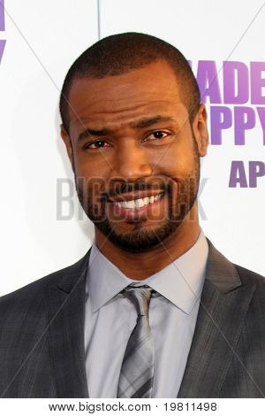 LOS ANGELES - APR 19:  Isaiah Mustafa arrives at the