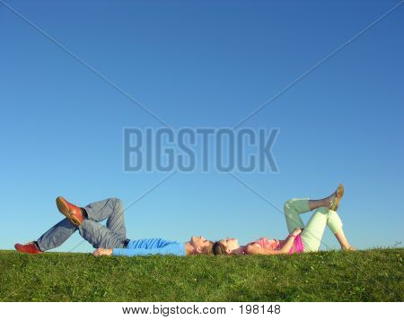 Couple Lies On Blue Sky