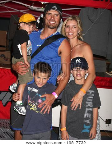 LOS ANGELES - MAY 1: Joshua Morrow, with wife Tobe, and sons Cash, Crew, & Cooper arriving at the 1st Annual Ball Up Celebrity Streetball Game at CSUN Matadome Stadium on May 1, 2011 in Northridge, CA