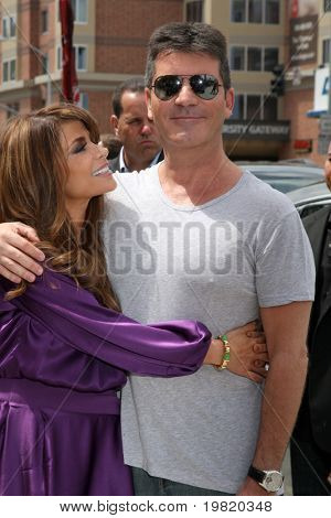 LOS ANGELES - MAY 8:  Paula Abdul & Simon Cowell , two of the talent judges arriving at the