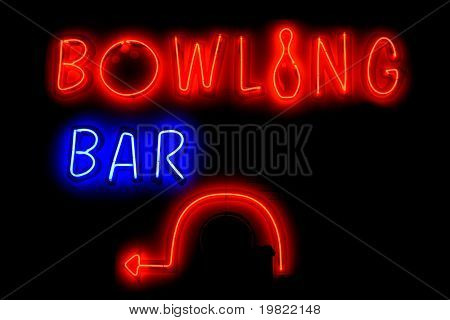 Blue and red neon sign of the words 'Bowling bar' with a left arrow, on a black background.