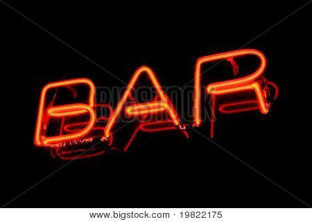 Red neon sign of the word 'Bar' on a black background.
