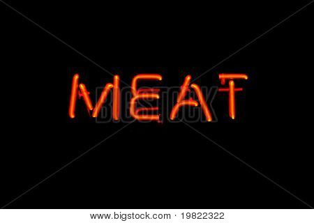 Red neon sign of the word 'Meat' on a black background.