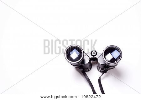 Binoculars isolated on a white background with copyspace.