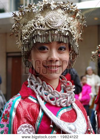 Beautiful Chinese dancing girl at New Year Parade in Chinatown London