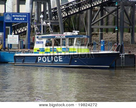 Metropolitan police boat on river thames in London