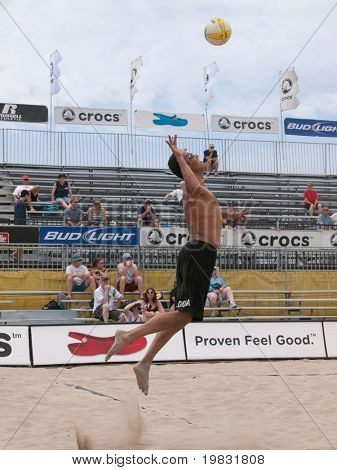 HUNTINGTON BEACH, CA. - MAY 22: AVP Huntington Beach Open, Jose Loiola serving at the Huntington Beach Open on May 22, 2009.