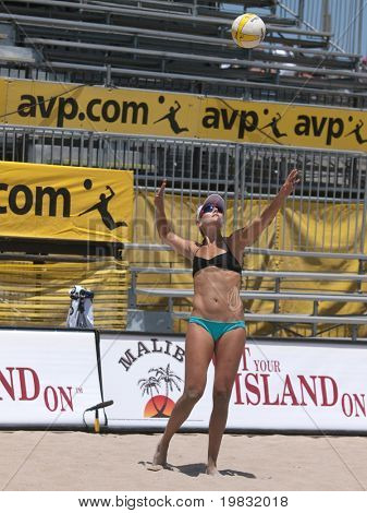 HUNTINGTON BEACH, CA. - MAY 23: Jen Kessy serving at the AVP Huntington Beach Open south of the pier on the weekend May 23, 2009 in Huntington Beach, California.