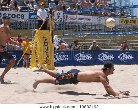 HUNTINGTON BEACH, CA. - MAY 23: Todd Rogers diving for the ball at the AVP Huntington Beach Open south of the pier on the weekend of the 22nd -24th in Huntington Beach, California May 23rd 2009