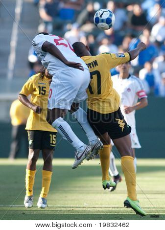 CARSON, CA. - JULY 3: Concacaf Gold Cup soccer match, Canada vs. Jamaica at the Home Depot center in Carson. Rodolph Austin and Patrice Bernier making a move for the ball on July 3, 2009.