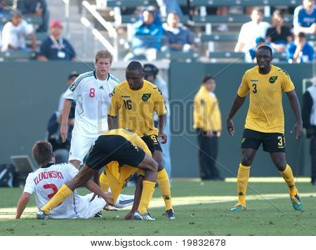 CARSON, CA. - JULY 3: Concacaf Gold Cup soccer match, Canada vs. Jamaica at the Home Depot Center in Carson. Michael Klukowski fouling Ricardo Gardner during the game. July 3, 2009.