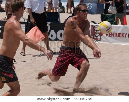 MANHATTAN BEACH, CA. - JULY 18: Jeff Carlucci and Adam Roberts at the AVP Manhattan Beach Open on July 18, 2009 in Manhattan Beach, CA.
