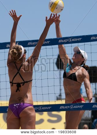HERMOSA BEACH, CA. - AUGUST 8: Jen Kessy and April Ross (L) vs. Nicole Branagh and Elaine Youngs (R) for the womens final of the AVP Hermosa Beach Open. August 8, 2009 in Hermosa Beach.