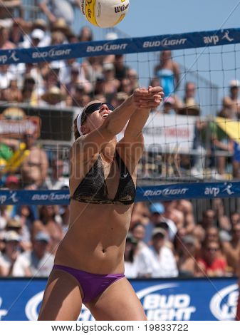 HERMOSA BEACH, CA. - AUGUST 8: Jen Kessy and April Ross (pictured) vs. Nicole Branagh and Elaine Youngs for the womens final of the AVP Hermosa Beach Open. August 8, 2009 in Hermosa Beach.