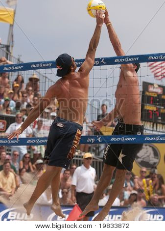 HERMOSA BEACH, CA. - AUGUST 9: Phil Dalhausser and Todd Rogers (L) vs. John Hyden and Sean Scott (R) for the mens final of the AVP Hermosa Beach Open. August 9, 2009 in Hermosa Beach.