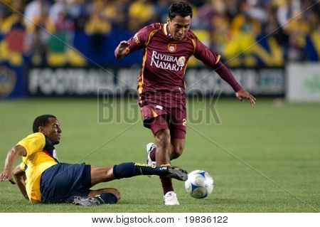CARSON, CA. - JANUARY 9: Elgabry Rangel (R) tackled by Adolfo Rosinei (L) during the InterLiga 2010 match of Club America & Estudiantes Tecos at the Home Depot Center January 9, 2010 in Carson, CA.