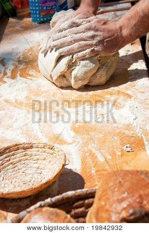 Baker Hands Kneading Dough