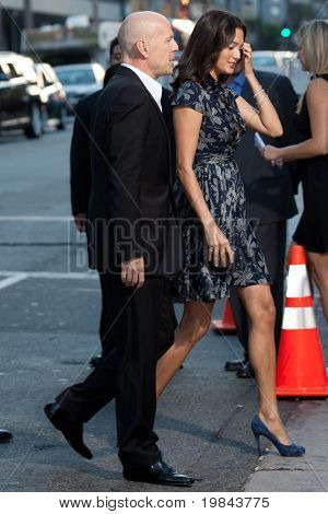 HOLLYWOOD, CA. - AUG 3: Emma Heming (R) and Bruce Willis (L) arrive at The Expendables Los Angeles premiere at Grauman's Chinese Theater on August 3, 2010 in Hollywood, Ca.
