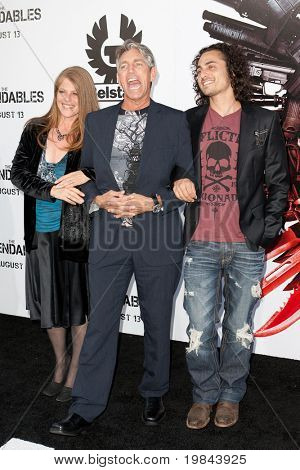 HOLLYWOOD, CA. - AUG 3: Eric Roberts (mid) and guests arrive at The Expendables Los Angeles premiere at Grauman's Chinese Theater on August 3, 2010 in Hollywood, Ca.