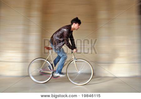 Young man on a fixed-gear bicycle