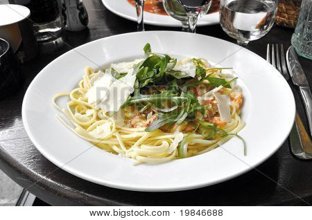 Spaghetti served with prawns and Parmigiano