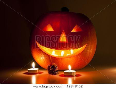 Halloween pumpkin lantern and a small skull