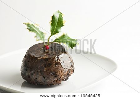 Christmas pudding decorated with holly leaves