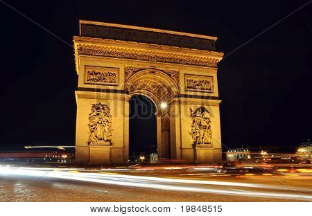 The Arc de Triomphe at night in Paris, France